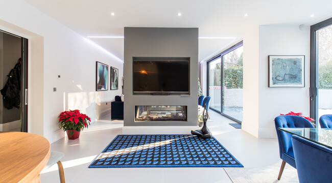 Open plan fireplace new build in North London by Aubrey Homes