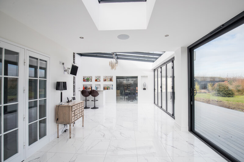 Open plan steel framed glass extension dining room Hertfordshire by Aubrey Homes