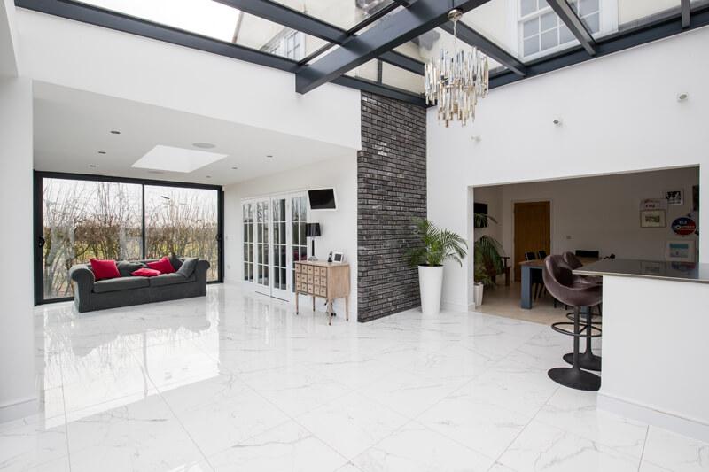 Open plan steel framed glass extension Hertfordshire by Aubrey Homes