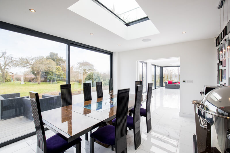 Steel framed glass extension dining room Hertfordshire by Aubrey Homes