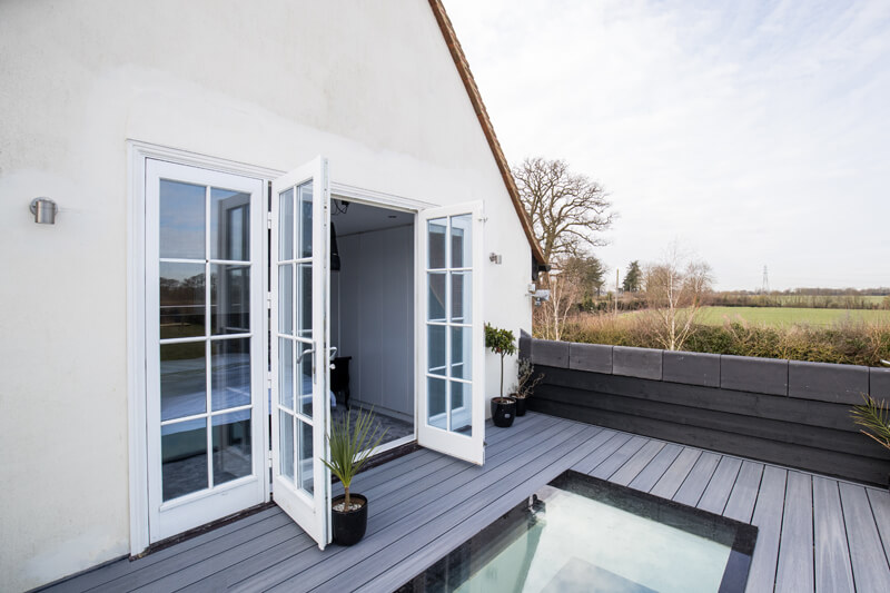 Top deck of Steel framed glass extension Hertfordshire by Aubrey Homes