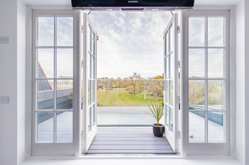 balcony of Steel framed glass extension Hertfordshire by Aubrey Homes