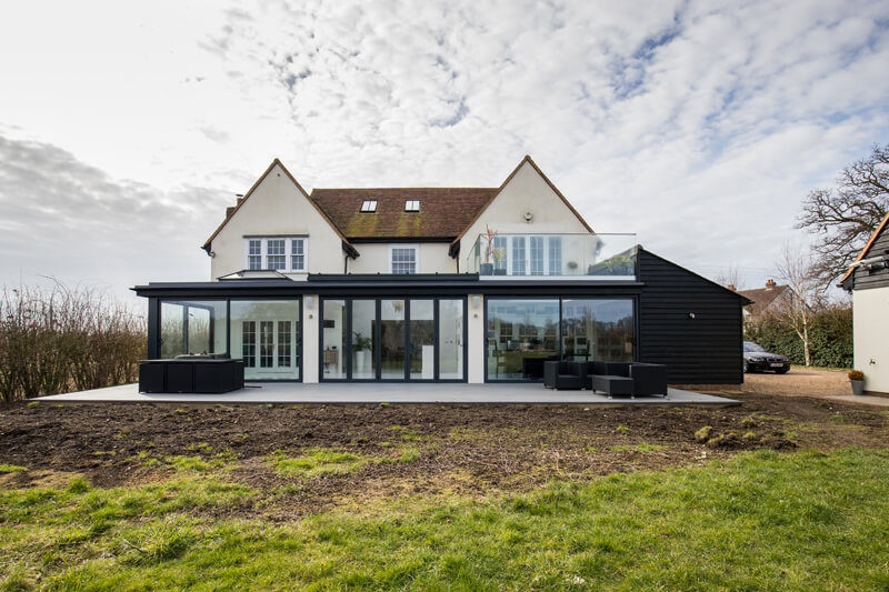 Steel framed glass extension outside view Hertfordshire by Aubrey Homes