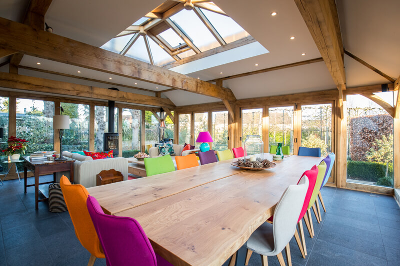 Oak framed extension dining room Cambridgeshire by Aubrey Homes