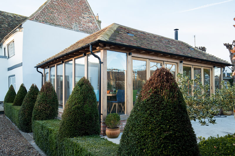 Oak framed extension side view Cambridgeshire by Aubrey Homes